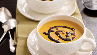Photo of Creamy Pumpkin-Coconut Soup with Spiced Oil Drizzle